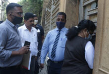Photo of Narcotics Control Bureau (NCB) officials at Shah Rukh Khan's house Mannat